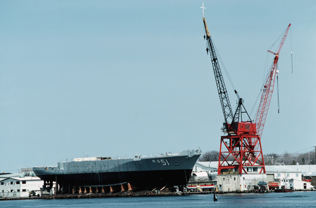 A starboard side view of the Safeguard class salvage ship GRASP (ARS 51) on blocks prior to its lauching at Peterson Builders Inc