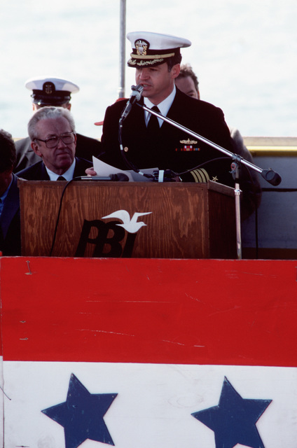 Captain Paul M. Robinson, supervisor of shipbuilding at Peterson Builders Inc., speaks during the launching ceremony for the Safeguard class salvage ship GRASP (ARS 51)