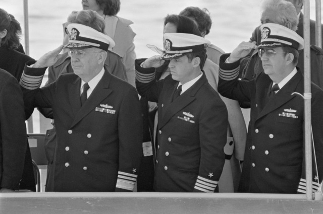 Officers salute from the speakers' platform during the launching ceremony for the Safeguard class salvage ship GRASP (ARS 51) at Peterson Builders Inc. They include Vice Admiral Earl B. Fowler, left, Commander, Naval Sea Systems Command, and Captain Paul Robinson, center, supervisor of shipbuilding at Peterson