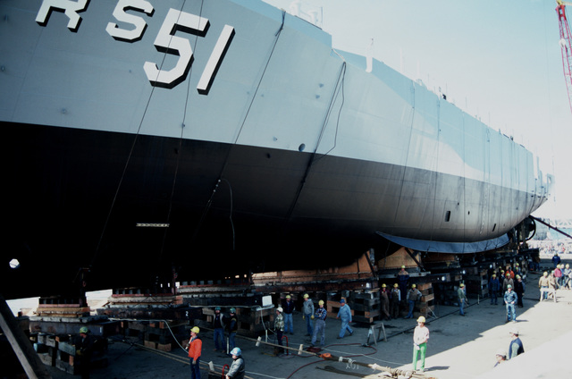 Shipyard workers stand by to launch the Safeguard class salvage ship Grasp (ARS 51) at Peterson Builders Inc