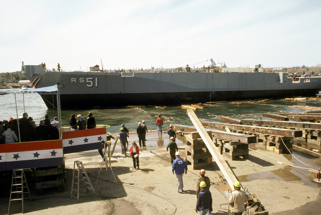 The christening party looks on from the christening platform as the Safeguard class salvage ship USS GRASP (ARS 51) is side-launched by shipyard workers at Peterson Builders Inc