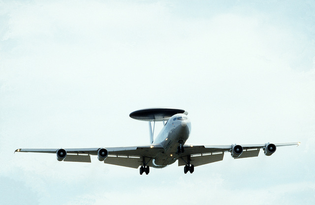 A bottom right front view of an E-3A Sentry Airborne Warning and Control System (AWACS) aircraft from the 961st AWACS Squadron in-flight. The E-3A is being used to provide airborne radar control during Pitch Black '84, a joint U.S., Australia, New Zealand exercise