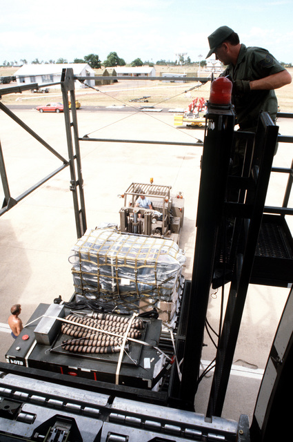 A Cochran loader is used to offload equipment and supplies from a KC-10A Extender aircraft during the joint Australia/New Zealand/US Exercise PITCH BLACK '84