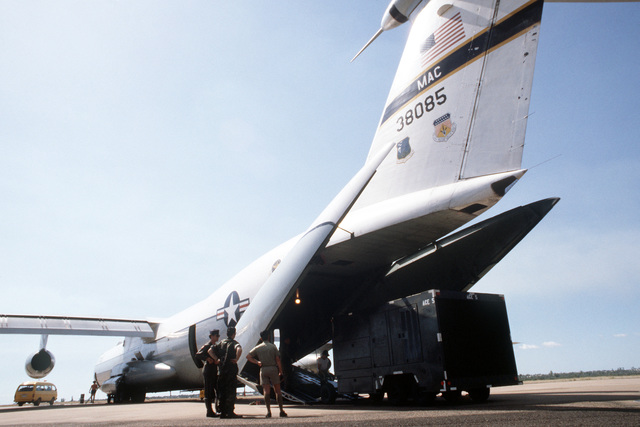 An oversize Environmental Control System for an E-3A Sentry Airborne Warning and Control System (AWACS) aircraft is loaded aboard a C-141B Starlifter aircraft during PITCH BLACK 84. PITCH BLACK is a joint US, Australian and New Zealand exercise