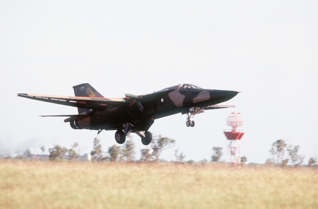 Right side view of an Australian F-111 fighter aircraft taking off during PITCH BLACK 84, a joint US, Australian and New Zealand exercise