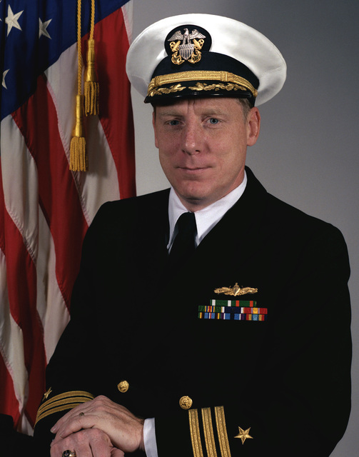 Commander John C. Overton, USN (covered)