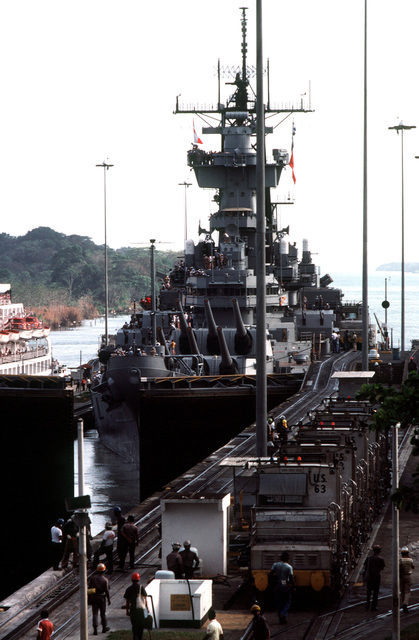 The battleship USS NEW JERSEY (BB 62) enters the lower level, east chamber of Gatun Locks to begin a transit of the Panama Canal. The cruise ship ISLAND PRINCESS (background) enters the west chamber at the same time