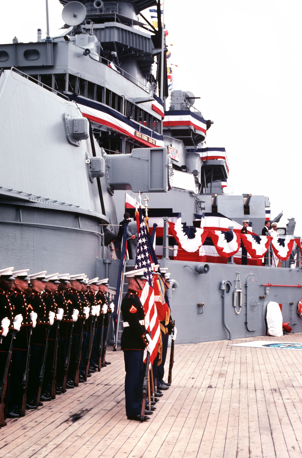 A Marine Corps honor guard and color guard participate in the recommissioning ceremony for the battleship USS IOWA (BB 61). They are part of the battleship's Marine Detachment - U.S. National Archives