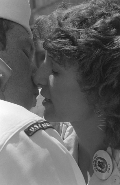 A sailor gets a welcome home kiss upon his return to home port after 11 months at sea aboard the battleship USS NEW JERSEY (BB 62)