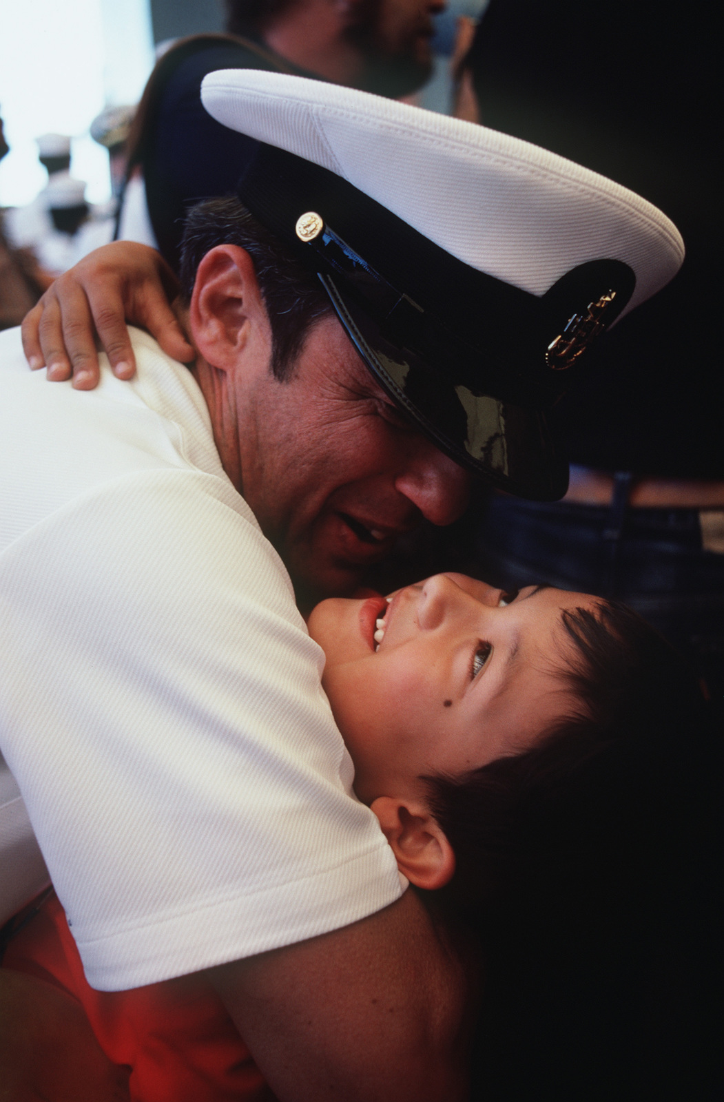 CHIEF Aviation Structural Mechanic S (Structures) (AMSC) Ricardo Garza hugs his son upon returning to home port after 11 months at sea aboard the battleship USS NEW JERSEY (BB 62)