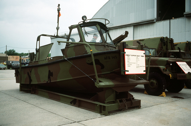 An Army combat support boat used in setting up a portable ribbon bridge is displayed at the Department of Defense open house air show