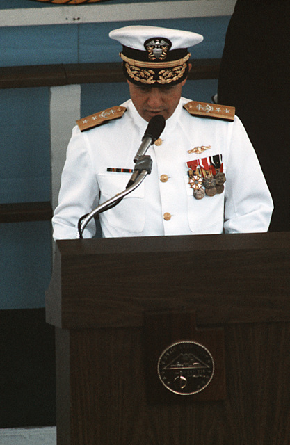 Rear Admiral Stanley G. Catola, Commander, Submarine Group 6, reads the commissioning ceremony for the nuclear-powered attack submarine USS SALT LAKE CITY (SSN 716)