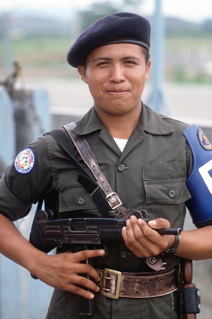 A Honduran air force security policeman, armed with an Uzi submarine gun, provides protection for personnel participating in Exercise GRANADERO I