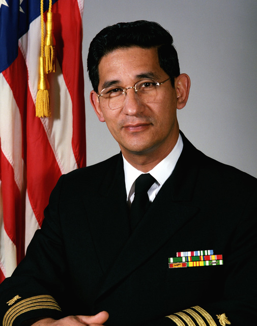 Captain Calvin K. Yim, USN (covered)
