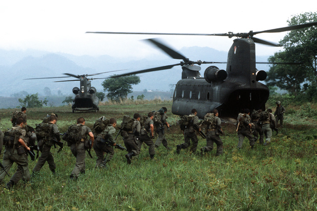 Soldiers from the 7th Battalion, Honduran army, board U.S. Army CH-47D Chinook helicopters during exercise Granadero I