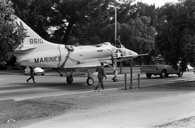 STAFF Sergeant Byington rides in the cockpit of a towed A-4 Skyhawk aircraft. The aircraft, formerly on exhibit at the Navy-Marine Corps and Coast Guard Museum, has been donated to Encinal High School in Alameda, California