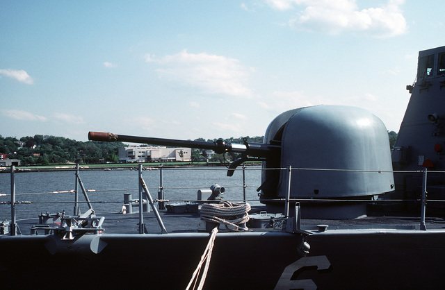 A port side view of the Mark 75 76mm OTO Melara gun on the bow of the patrol combatant missile hydrofoil USS GEMINI (PHM-6). The ship is at the Washington Navy Yard for a port visit