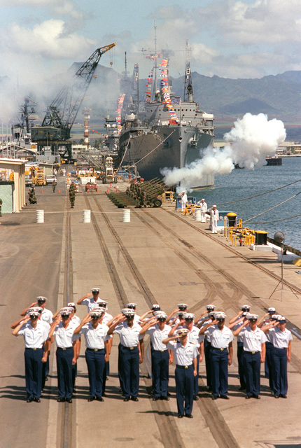 A Coast Guard honor guard salutes and howitzers are fired during the designation and departure ceremony for the Unknown Serviceman of the Vietnam Era. At the conclusion of the ceremony, the Unknown will be placed aboard the frigate USS BREWTON (FF 1086) and transported to Naval Air Station Alameda, California. The repair ship USS JASON (AR 8) is visible in the background