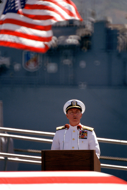 Admiral Sylvester R. Foley Jr., commander-in-chief of the Pacific Fleet, speaks at a ceremony honoring the Unknown Serviceman of the Vietnam Era. The serviceman's casket will be transported aboard the frigate USS BREWTON (FF 1086) to Alameda, California, and then transferred to Arlington National Cemetery for interment at the Tomb of the Unknowns