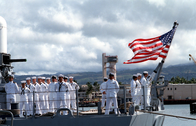 Crewmen stand at parade rest as the casket of the Unknown Serviceman of the Vietnam Era is carried aboard the frigate USS BREWTON (FF 1086), at the conclusion of a wreath-laying ceremony. The casket will be transported to California and then transferred to Arlington National Cemetery for interment at the Tomb of the Unknowns