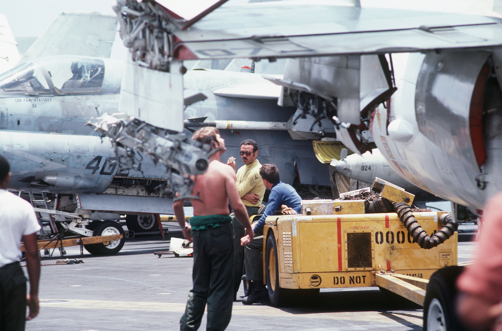 Maintenance is performed on A-7 Corsair II aircraft aboard the aircraft carrier USS MIDWAY (CV 41)