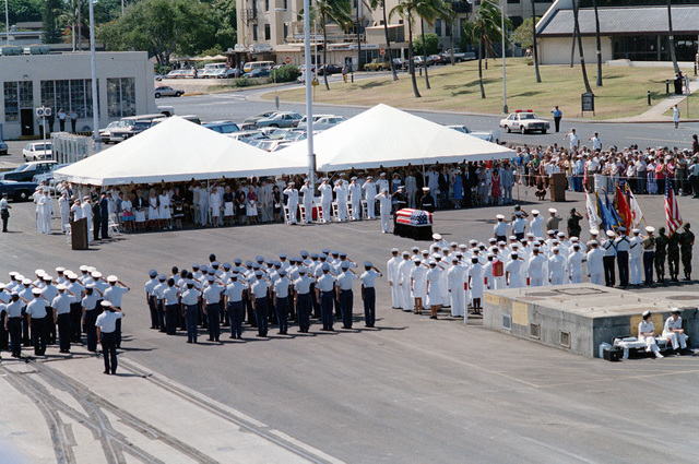 Military honor guards render a final salute to the Unknown Serviceman of the Vietnam Era at the conclusion of the designation and departure ceremony. The Unknown will be placed aboard the frigate USS BREWTON (FF 1086) for transport to Naval Air Station, Alameda, California