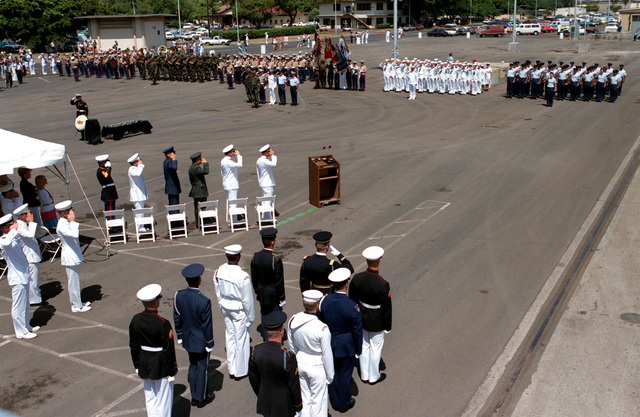 Personnel from all of the military services salute the Unknown Serviceman of the Vietnam Era, after his casket is placed aboard the frigate USS BREWTON (FF 1086). The casket will be transported to California and then transferred to Arlington National Cemetery for interment at the Tomb of the Unknowns