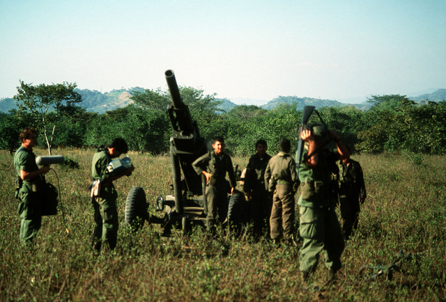 An audiovisual crew prepares to videotape Honduran soldiers as they train on the operation of an M102 105 mm howitzer during the joint US/Honduras field training Exercise AHUAS TARA II (BIG PINE)