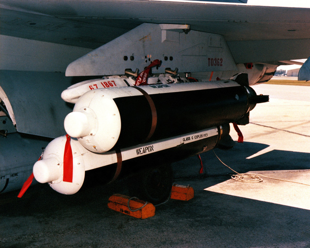 Two Mark 7 Gator all-altitude spin projectile (ASP) anti-tank weapons attached to the wing pylon of an F-4 Phantom II aircraft parked on the flight line