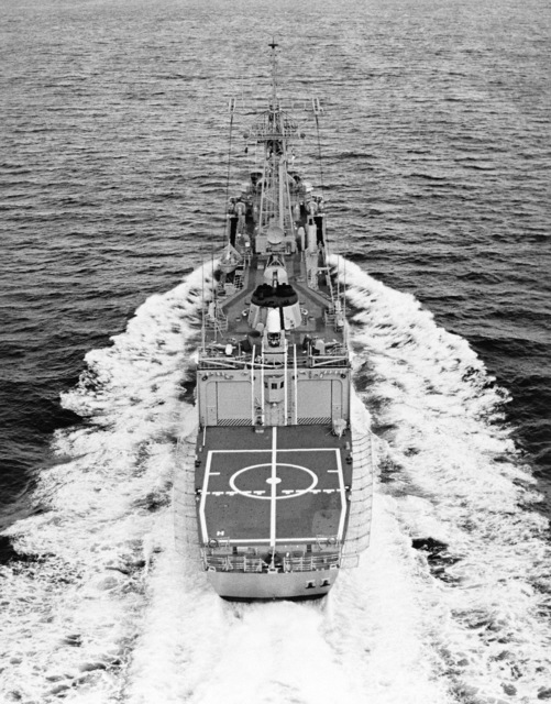 Aerial stern view of the HMAS DARWIN (F 04) underway. This frigate (US hull number FFG 44) was built for Australia by Todd Pacific Shipyard Corporation, Seattle, Washington