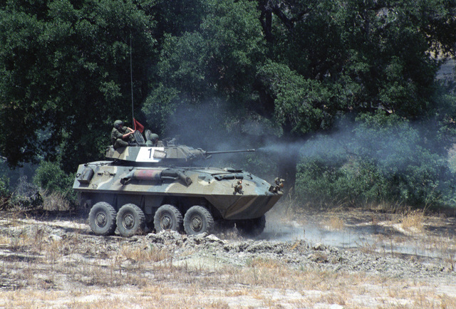 Right side view of an LAV25 light armored vehicle firing a 25 mm M242 chain gun