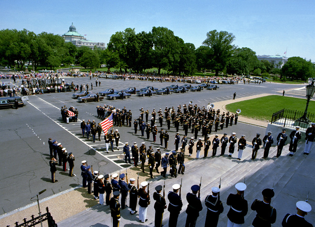 A joint services casket team, preceded by a special joint Chiefs of STAFF honor guard and chaplains from the various services, carries the casket of the Unknown Serviceman of the Vietnam Era up the Capitol steps into the rotunda. The Unknown will lie in state until May 28 when the interment will take place at the Tomb of the Unknowns in Arlington National Cemetery