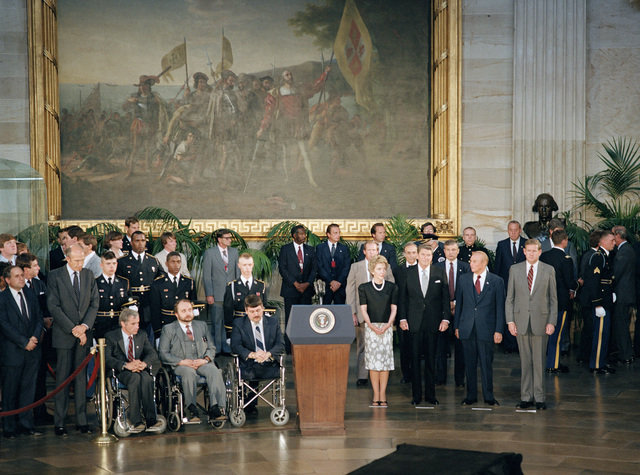 President and Mrs. Ronald Reagan, VIP's, Vietnam veterans, and other guests wait for the Unknown Serviceman of the Vietnam Era to be brought into the Capitol rotunda during an arrival ceremony. The Unknown will lie in state in the rotunda until Memorial Day, when he will be taken to Arlington National Cemetery for internment at the Tomb of the Unknowns