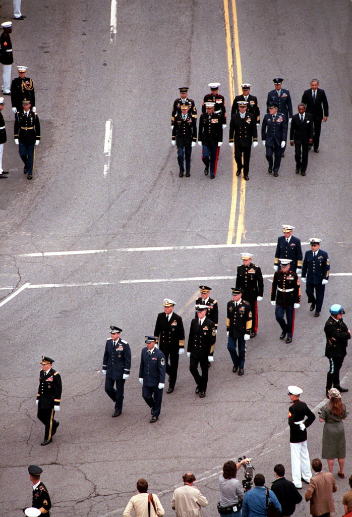 A special Joint Chiefs of STAFF honor guard, consisting of General (GEN) John W. Vessey Jr., Chairman, front, GEN C. Gabriel, Admiral (ADM) J. Watkins, GEN J. Wickham, GEN P. Kelley, ADM J. Gracey and their aides, marches in the funeral procession for the Unknown Serviceman of the Vietnam Era, en route to Arlington National Cemetery. They are followed by honorary pallbearers