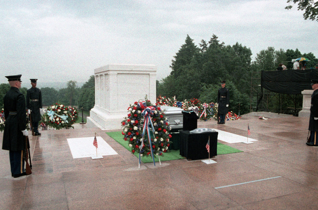Third Infantry (The Old Guard) sentries stand guard at the Tomb of the Unknowns at the conclusion of the internment ceremony for the Unknown Serviceman of the Vietnam Era. The Presidential Wreath and the Medal of Honor have been placed at the base of the Unknown's casket