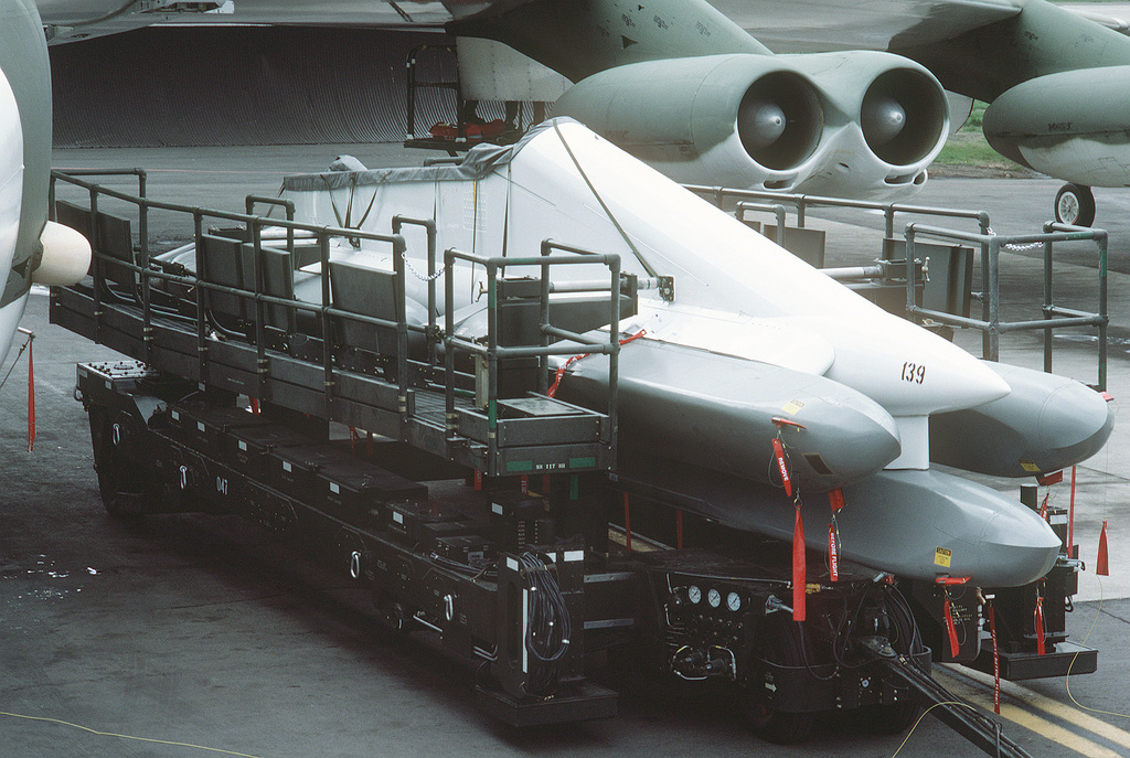 A specially-designed remote control hydraulic trailer is used to attach a pylon carrying six AGM-86B air-launched cruise missiles (ALCM) to the wing of a 92nd Bomb Wing B-52G Stratofortress aircraft