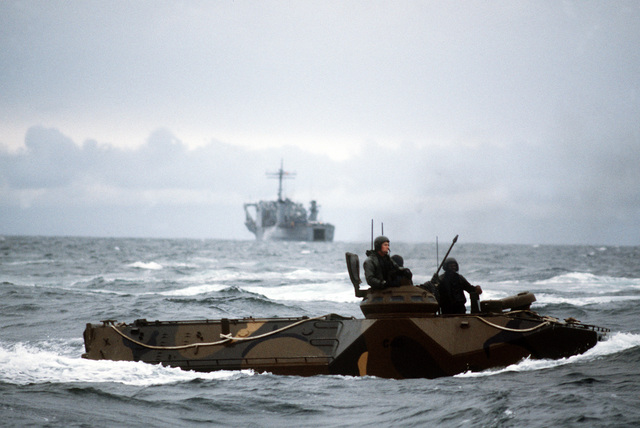Marines aboard a Personnel Tracked Landing Vehicle (LVTP-7) await the signal to move toward the beach during Operation Unitas XXV. A Newport Class tank landing ship is visible in the background