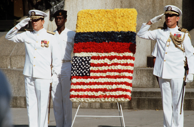Rear Admiral Clinton Taylor, left, UNITAS XXV task force commander, salutes during a wreath laying ceremony in Guayaquil