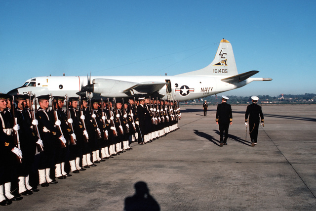 Rear Admiral Clinton Taylor, UNITAS XXV task force commander, reviews Paraguayan naval forces during a visit to the capital city of Asuncion. A P-3 Orion aircraft from Patrol Squadron 9 (VP-9) is visible in the background