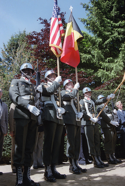 A color guard carrying the Belgian and American flags participates in a wreath-laying ceremony at the Patton Memorial on the 40th anniversary of D-day, the invasion of Europe