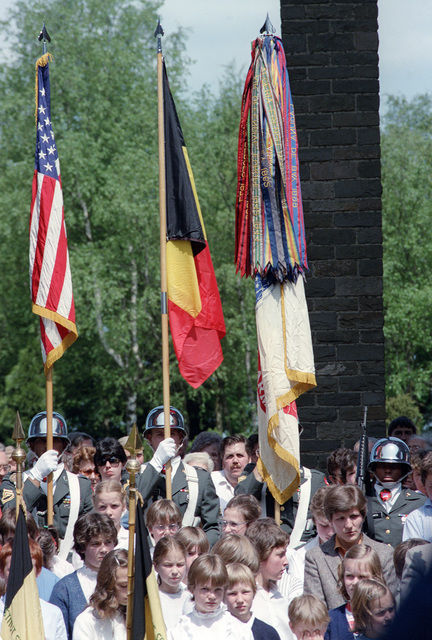 A color guard carrying the Belgian and American flags paticipates in a wreath-laying ceremony at the Madison Memorial on the 40th anniversary of D-day, the invasion of Europe