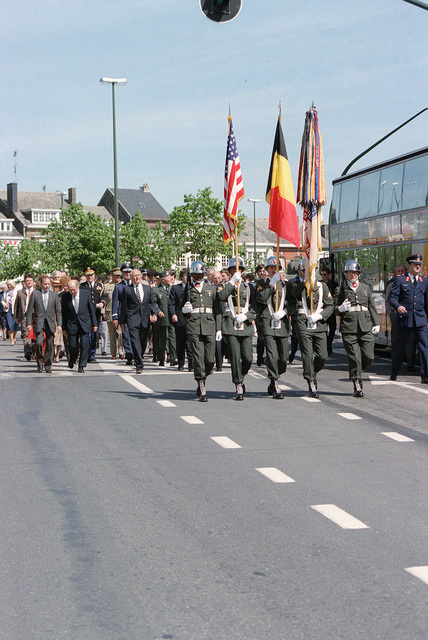 A color guard carrying the US and Belgian flags marches in a parade commemorating the 40th anniversary of D-Day, the invasion of Europe