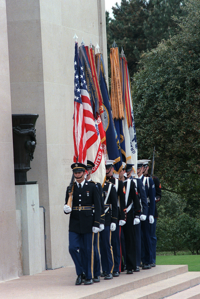 A color guard participates in a wreath-laying ceremony at the American cemetery at Omah Beach on the 40th anniversary of D-day, the invasion of Europe