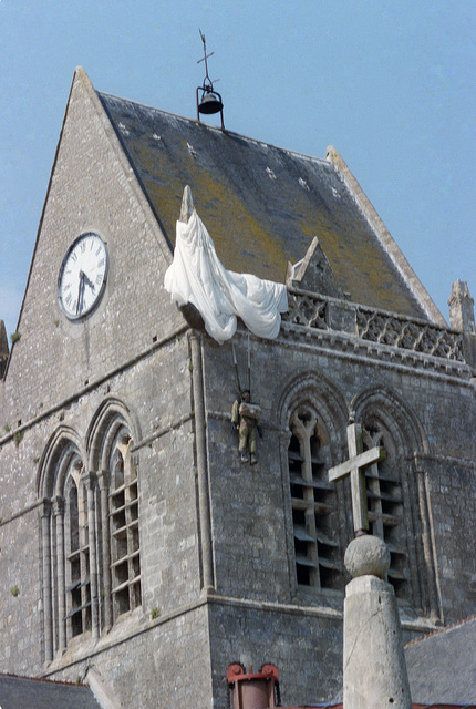 A dummy paratrooper hangs from a church steeple on the 40th anniversary of D-Day, the invasion of Europe. During the actual invasion a paratrooper became stuck on the steeple