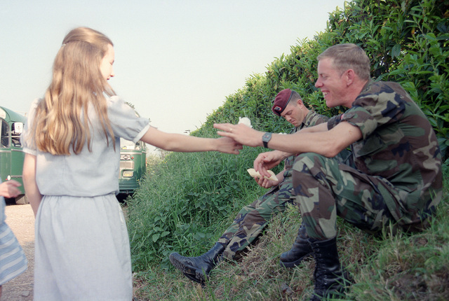 A French girl presents a flower to a member of the 82nd Airborne Division on the 40th anniversary of D-day, the invasion of Europe