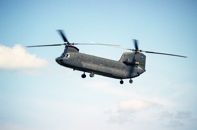 A left side view of a CH-47 Chinook helicopter participating in a ceremony commemorating the 40th anniversary of D-day, the invasion of Europe