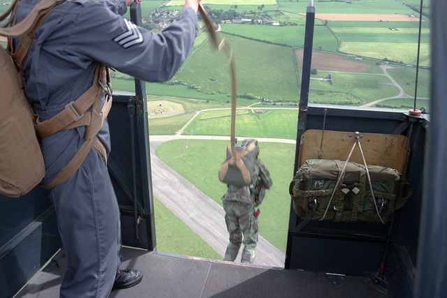 A member of the 82nd Airborne Division and a British paratrooper jump from a tethered balloon in preparation for a jump into Sainte-Mere-Eglise, France, on the 40th anniversary of D-day, the invasion of Europe