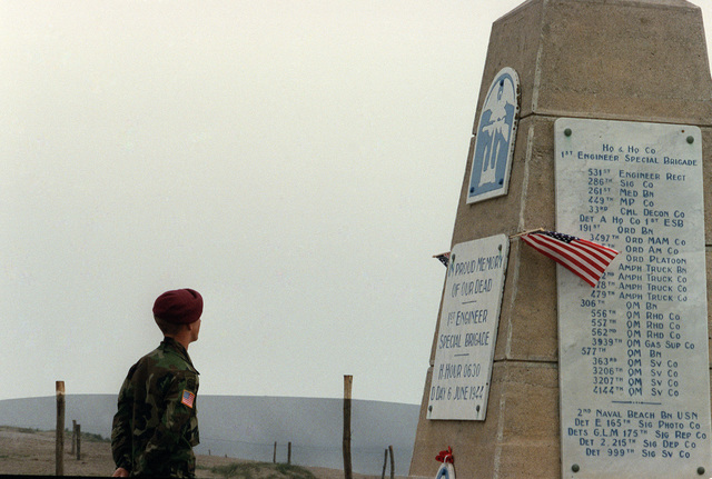 A soldier of the 82nd Airborne Division visits a war memorial on the 40th anniversary of D-day, the invasion of Europe