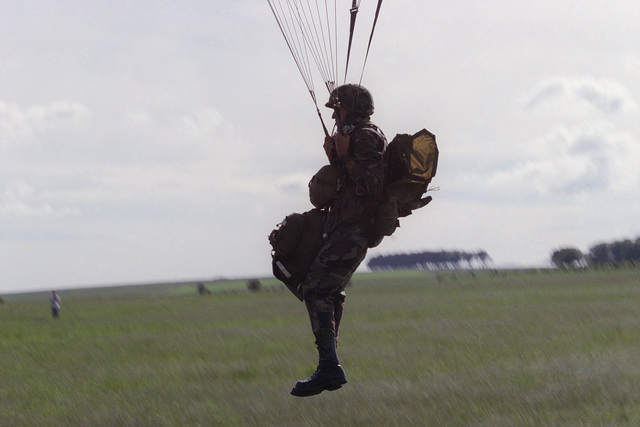 A soldier of the US Army 82nd Airborne Division participates in a parachute jump during the 40th anniversary celebration of D-Day, the invasion of Europe