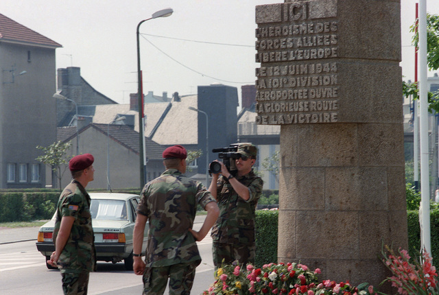 A soldier videotapes members of the 82nd Airborne Division during their visit to a war memorial on the 40th anniversary of D-Day, the invasion of Europe